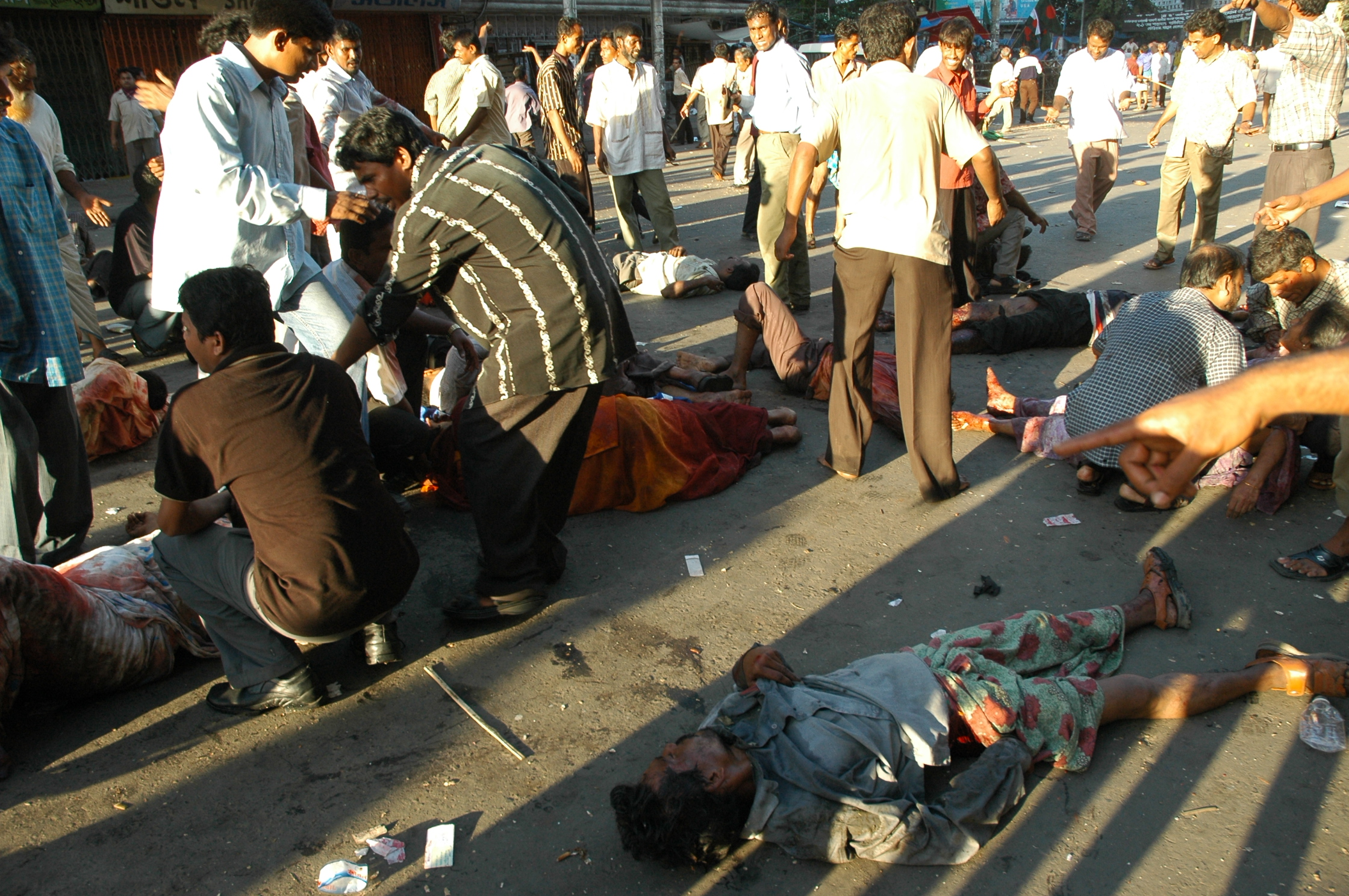 Just after the blast at the protest rally on Dhaka's Bangabandhu Avenue on August 21, 2004, rescuers try to lift a shell-shocked Ivy Rahman with both her legs badly mauled. Photo: Star