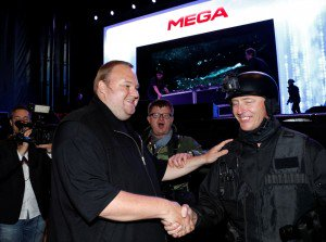 """An actor in police costume greets Megaupload founder Kim Dotcom (L) as he launches his new file sharing site """"Mega"""" in Auckland. Photo: Reuters"""