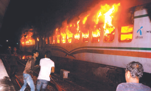 A train is set on fire by Jamaat activists during a hartal in early March.  Photo: Star File