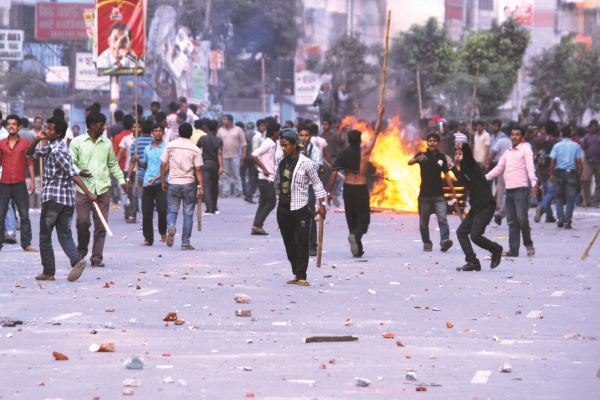 Broken bricks, raging flames and youths with lethal weapons - a common scene in the streets these days.Photo: Star File