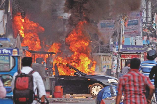 A car burns after the BNP demonstration in front of its Nayapaltan head office was foiled yesterday. Photo: Star
