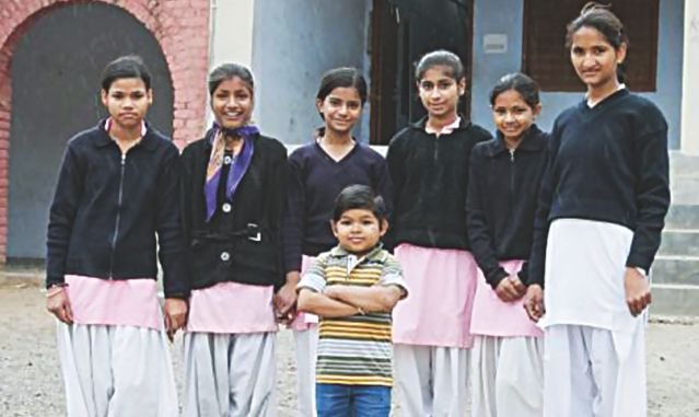 Pupils aged 12 call their teacher Azad Singh 'Chotu' meaning 'Little Sir' because he is just 3ft tall. Photo: Dailymail