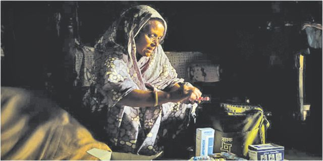 A health worker is distributing TB drugs at community level in Bangladesh as a part of National Tuberculosis Control Programme.