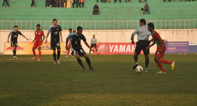 Bangladesh players (sporting red shirt) played all out against a nondescript Northern Mariana Islands in their final AFC Challenge Cup Qualifying match at the Dasarath Stadium in Kathmandu yesterday. But the wasteful booters could score only four goals. Photo: Internet