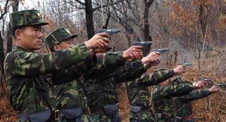 North Korean soldiers take part in a shooting drill in an unknown location in this picture taken on April 6, 2013 and released by North Korea's official KCNA news agency in Pyongyang on April 7. Photo: Reuters