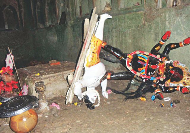 Broken idols lie scattered as unidentified attackers went on the rampage inside a temple of goddess Kali at Galachipa upazila in Patuakhali on Monday. Photo: Star