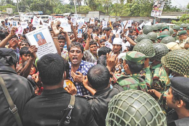 Relatives of the people yet to be found after the Rana Plaza collapsed on Wednesday demonstrate near the site in Savar yesterday.  Photo: Rashed Shumon