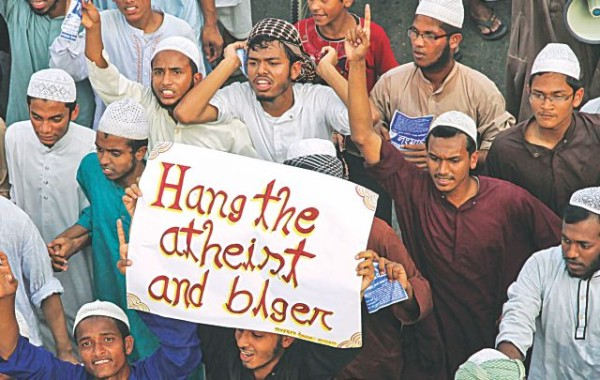 "Apparently craving international attention, members of Hefajat-e Islam bring out a procession in the capital's Demra yesterday with an English placard where the word blogger is spelt ""blger"". The procession was to drum up support for their Dhaka long march tomorrow demanding punishment of atheists and bloggers. But how much they know about the bloggers or what they do remain a wonder. Photo: Star"