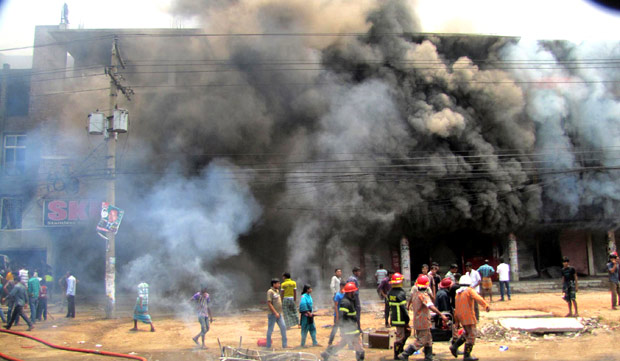 Protesting garment factory workers set fire to a building in Gazipur on Friday. Photo: Focus Bangla