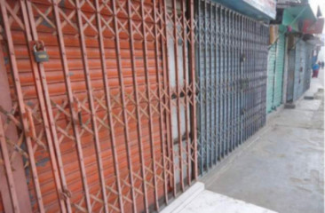 Shop owners keep shutters down during hartal (shutdown) hours fearing vandalism. Star file photo
