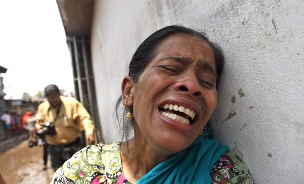 A garment worker who survived the Savar building collapse wails as her sister, also colleague, was buried under the rubble on Wednesday morning. Photo: Rashed Shumon