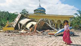 97 dead as earthquake hits western Indonesia