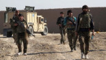 Afghan Taliban: Helmand town police HQ 'under siege'