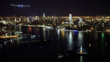 Solar Impulse flies over night-time New York