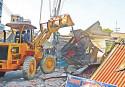 Bangladesh Railway demolishes a structure