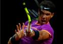 Wawrinka falls, Djokovic and Nadal into quarters