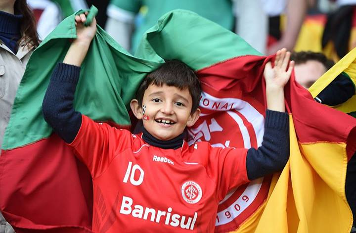 A young Algerian fan cheers before a Round of 16 football match between Germany and Algeria at Beira-Rio Stadium in Porto Alegre during the 2014 FIFA World Cup. Photo: Getty Images.