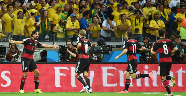 Germany's players celebrate after midfielder Sami Khedira (L) scored his team's fifth goal during their World Cup semi-final match with Brazil in Belo Horizonte on July 8, 2014. Photo: Getty Images