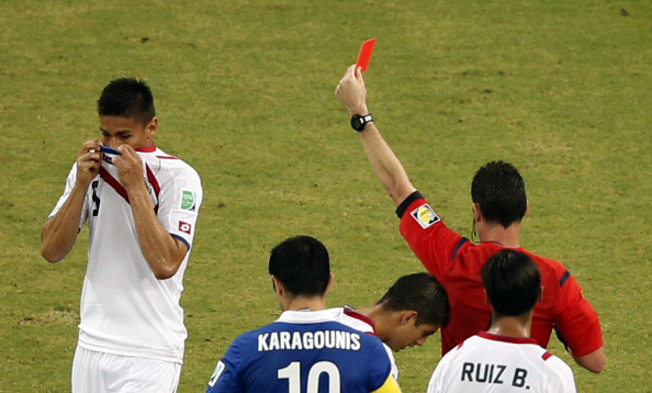 Costa Rica defender Oscar Duarte (L) is sent off by Australian referee Benjamin Williams during their round of 16 match against Greece in Recife during the 2014 FIFA World Cup on June 29, 2014. Photo: Getty Images