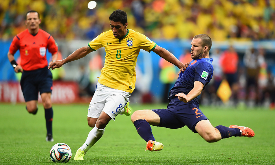 Ron Vlaar of the Netherlands challenges Paulinho of Brazil during their World Cup third place play-off match at the National Stadium in Brasilia on July 12, 2014. Photo: Getty Images