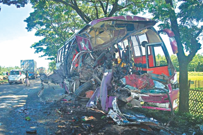 The mangled wreckage of the bus after it had a head-on collision with a truck on the Dhaka-Chittagong highway at Sitakunda. Four people died in the accident. Photo: Star