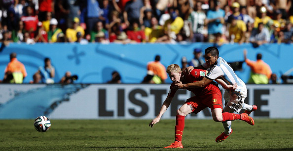 Belgium's midfielder Kevin De Bruyne (L) vies with Argentina's midfielder Lucas Biglia during their World Cup quarter-final match at the Mane Garrincha National Stadium in Brasilia on July 5, 2014. Photo: Getty Images