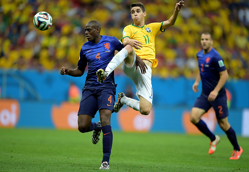 Oscar of Brazil and Bruno Martins Indi of the Netherlands compete for the ball during their World Cup third place play-off match at the National Stadium in Brasilia on July 12, 2014. Photo: Getty Images