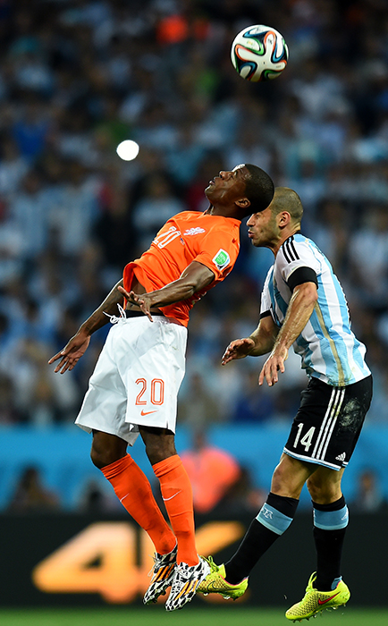 Georginio Wijnaldum of the Netherlands and Javier Mascherano of Argentina clash during their semi-final match at The Corinthians Arena in Sao Paulo on July 9, 2014. Photo: Getty Images