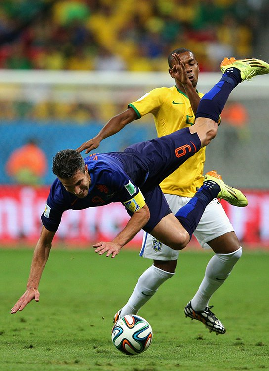 Fernandinho of Brazil challenges Robin van Persie of the Netherlands resulting in a yellow card for Fernandinho during their World Cup third place play-off match at the National Stadium in Brasilia on July 12, 2014. Photo: Getty Images