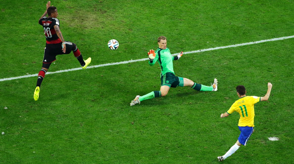 Brazil's Oscar scores his team's first goal past Jerome Boateng and goalkeeper Manuel Neuer of Germany during their FIFA World Cup semi-final on July 8, 2014 in Belo Horizonte, Brazil. Photo: Getty Images
