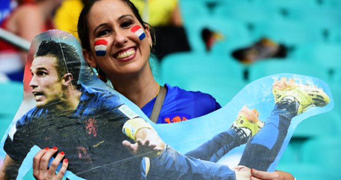 A Netherlands' fan holds a cut-out of Netherlands' forward and captain Robin van Persie as she awaits the kick-off of the quarter-final football match between Netherlands and Costa Rica at the Fonte Nova Arena in Salvador during the 2014 FIFA World Cup on July 5, 2014. Photo: Getty Images