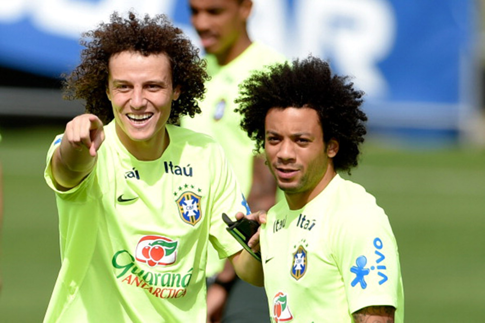 David Luiz gestures with Marcelo (R) during a training session of the Brazilian national football team at the squad's Granja Comary training complex, on July 07, 2014 in Teresopolis, Brazil. Photo: Getty Images