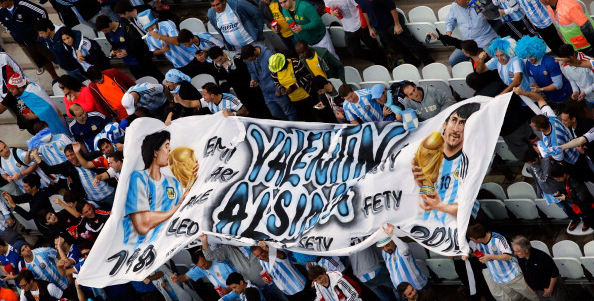 Argentinian fans cheer before the semi-final football match between Netherlands and Argentina of the FIFA World Cup at The Corinthians Arena in Sao Paulo on July 9, 2014. Photo: Getty Images