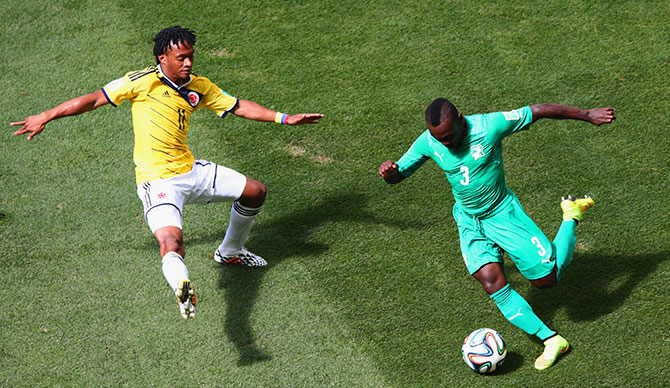 Arthur Boka of the Ivory Coast controls the ball against Juan Guillermo Cuadrado of Colombia during the 2014 FIFA World Cup Brazil Group C match between Colombia and Cote D'Ivoire at Estadio Nacional on June 19, 2014 in Brasilia, Brazil. Photo: Getty Images