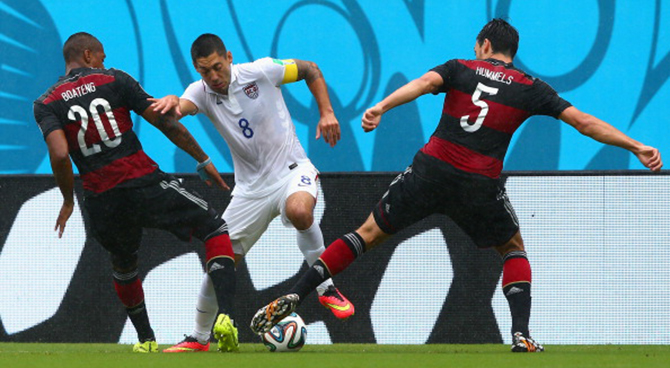 Clint Dempsey of the United States is challenged by Jerome Boateng (L) and Mats Hummels of Germany during the 2014 FIFA World Cup Brazil group G match between the United States and Germany at Arena Pernambuco on June 26, 2014 in Recife, Brazil. Photo: Getty Images