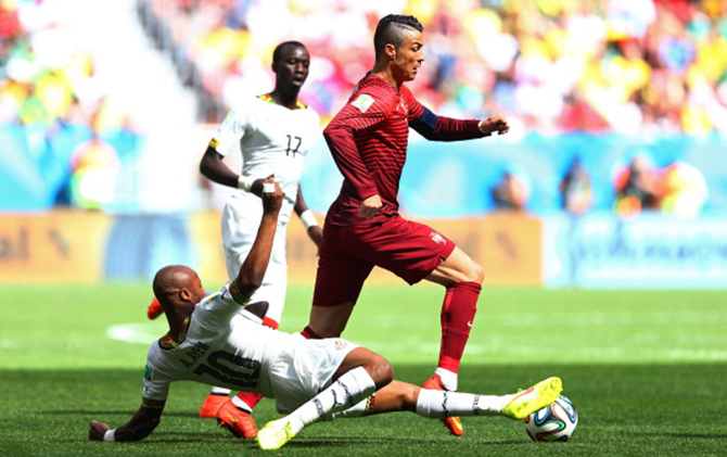 Andre Ayew of Ghana tackles Cristiano Ronaldo of Portugal during the 2014 FIFA World Cup Brazil Group G match between Portugal and Ghana at Estadio Nacional on June 26, 2014 in Brasilia, Brazil. Photo: Getty Images