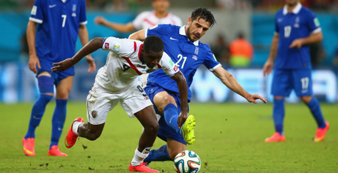 Joel Campbell of Costa Rica and Konstantinos Katsouranis of Greece compete for the ball during their World Cup Round of 16 match on June 29, 2014 in Recife, Brazil. Photo: Getty Images