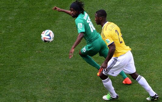 Ivory Coast's forward Gervinho (L) fights for the ball with Colombia's defender Cristian Zapata during a Group C football match between Colombia and Ivory Coast at the Mane Garrincha National Stadium in Brasilia during the 2014 FIFA World Cup on June 19, 2014. Photo: Getty Images