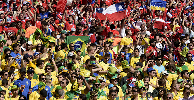 Brazil's and Chile's fans cheer prior to the Round of 16 football match between Brazil and Chile at The Mineirao Stadium in Belo Horizonte during the 2014 FIFA World Cup on June 28, 2014. Photo: Getty Images