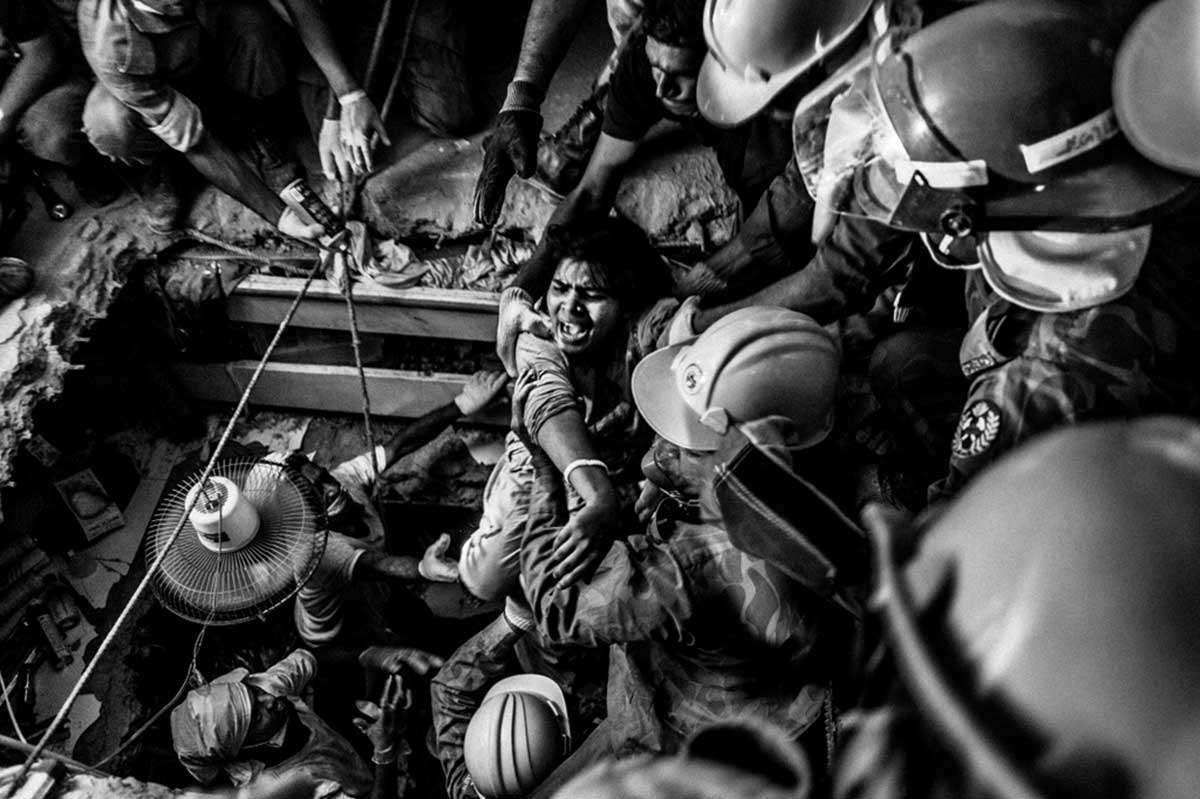 A rescued worker screams at the first sight of light after being trapped for 73 hours inside the rubble. Photo: Rahul Talukder