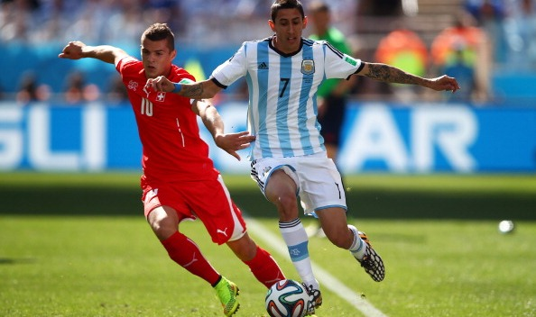 Granit Xhaka of Switzerland challenges Angel di Maria of Argentina during the 2014 FIFA World Cup Brazil Round of 16 match between Argentina and Switzerland at Arena de Sao Paulo on July 1, 2014 in Sao Paulo, Brazil. Photo: Getty Images