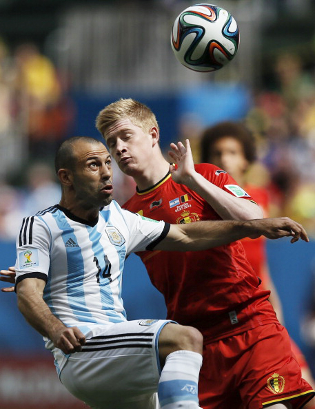 Argentina's midfielder Javier Mascherano (L) vies with Belgium's midfielder Kevin De Bruyne during their quarter-final match in Brasilia during the 2014 FIFA World Cup on July 5, 2014. Photo: Getty Images