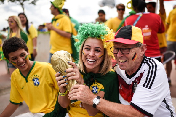 A Brazil and a Germany fan hold a replica of the World Cup trophy prior to the FIFA World Cup semi-final match between the two football heavyweights at Estadio Mineirao on July 08, 2014 in Belo Horizonte, Brazil. Photo: Getty Images