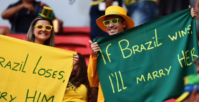 Brazilian fans pose before the start of the third place play-off football match between Brazil and Netherlands during the 2014 FIFA World Cup at the National Stadium in Brasilia on July 12, 2014. Photo: Getty Images