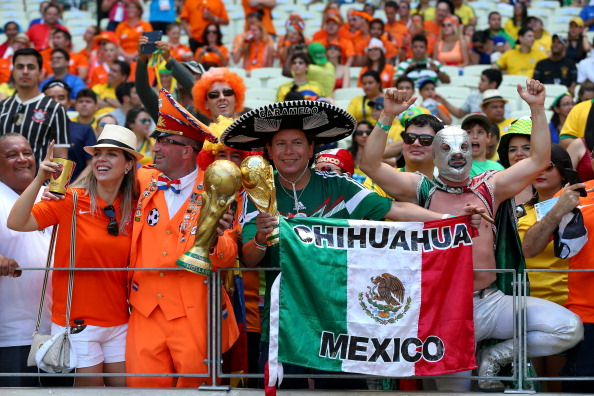 Mexico and Dutch fans soak up the atmosphere prior to the 2014 FIFA World Cup Brazil Round of 16 match between Netherlands and Mexico at Estadio Castelao on June 29, 2014 in Fortaleza, Brazil. Photo: Getty Images