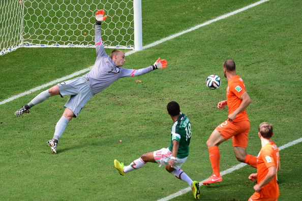 Netherlands' goalkeeper Jasper Cillessen (L) dives on a shot by Mexico's defender Andres Guardado (2ndL) during a Round of 16 football match between Netherlands and Mexico at Castelao Stadium in Fortaleza during the 2014 FIFA World Cup on June 29, 2014. Photo: Getty Images