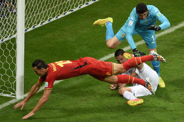 US forward and captain Clint Dempsey (C), Belgium's goalkeeper Thibaut Courtois (R) and Belgium's defender Daniel Van Buyten (L) vie for the ball during a Round of 16 football match between Belgium and USA at Fonte Nova Arena in Salvador during the 2014 FIFA World Cup on July 1, 2014. Photo: Getty Images