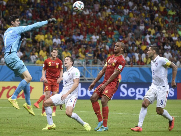 Belgium's goalkeeper Thibaut Courtois (L) punches the ball in front of Belgium's defender and captain Vincent Kompany (2R) during a Round of 16 football match between Belgium and USA at Fonte Nova Arena in Salvador during the 2014 FIFA World Cup on July 1, 2014. Photo: Getty Images)