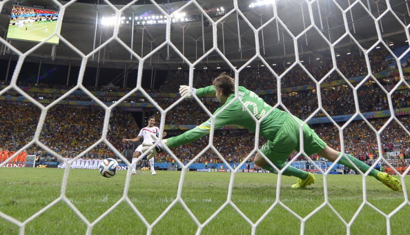 Netherlands' goalkeeper Tim Krul (R) fails to make a save from Costa Rica's midfielder Celso Borges during a penalty shoot-out after extra-time during a quarter-final football match between Netherlands and Costa Rica at the Fonte Nova Arena in Salvador during the 2014 FIFA World Cup on July 5, 2014. Photo: Getty Images