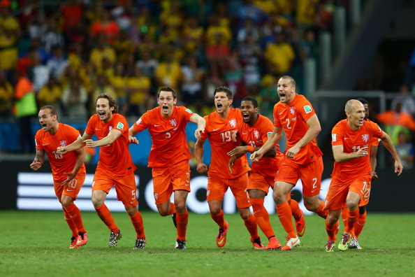Wesley Sneijder, Daley Blind, Stefan de Vrij, Klaas-Jan Huntelaar, Jeremain Lens, Ron Vlaar and Arjen Robben of the Netherlands celebrate victory in a penalty shootout against Costa Rica during the 2014 FIFA World Cup Brazil Quarter Final match between the Netherlands and Costa Rica at Arena Fonte Nova on July 5, 2014 in Salvador, Brazil. Photo: Getty Images